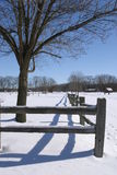 Winter Fence Line. Fence line and tree on a cold winter day after a new snow fall stock image