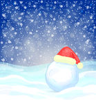Winter festive background. With snowflakes, snowdrifts, snowball and red Santa Claus' hat Royalty Free Stock Photography