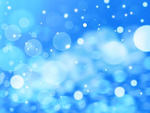 Winter Festive Christmas blue abstract background. With bokeh lights and stars Royalty Free Stock Image