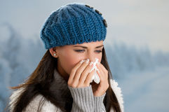Winter fever and flu. Pretty girl has flu and fever in winter day outdoor Stock Images