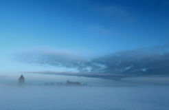 Winter field in fog Royalty Free Stock Photos