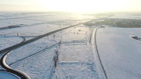 Winter field full of snow, view from drone. Aerial view over a field in the December, drone video stock footage