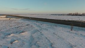 Winter field full of snow, view from drone. Aerial view over a field in the December, drone video stock video footage