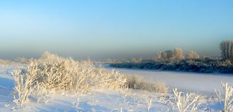 Winter field and river Stock Image