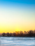 Winter fields at sunrise. With soft HDR effects Royalty Free Stock Images