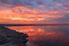 Winter Fiery Sunset in San Francisco Bay. Alviso Marina County Park is a gateway to the Don Edwards San Francisco Bay National Wildlife Refuge in San Jose stock photography