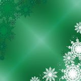 Winter Fine Ornate Snowflakes on the Green Iced Background. Winter Fine Ornate Snowflakes Placed in Corners on the Green Iced Background Royalty Free Stock Image