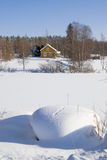 Winter in Finland. Small yellow house . Sunny day in winter Royalty Free Stock Images