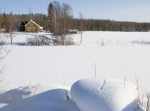 Winter in Finland. Small yellow house . Sunny day in winter Royalty Free Stock Image