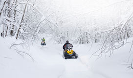 Winter Finnish snowy lanscape with road and snowmobile Royalty Free Stock Photography