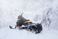 Winter Finnish snowy lanscape with road and snowmobile Stock Images