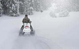 Winter Finnish snowy lanscape with road and snowmobile Royalty Free Stock Photos
