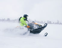 Winter Finnish snowy lanscape with road and snowmobile Stock Photography