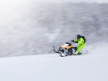 Winter Finnish snowy lanscape with road and snowmobile Stock Photos