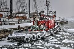 Winter fire boat. A moored fire boat in freezing winter Stock Photos