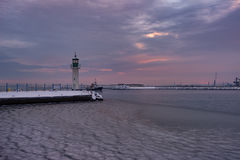 Winter fire sunset and frozen sea at the Marine station, Burgas, Bulgaria Royalty Free Stock Photography