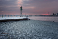 Winter fire sunset and frozen sea at the Marine station, Burgas, Bulgaria Royalty Free Stock Image