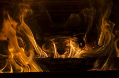 Winter fireplace with flames Royalty Free Stock Photos