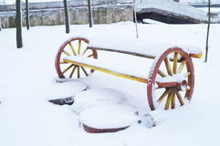 Winter. The first snow has covered decorative bench in the park. Stock Image
