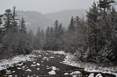 Winter first snow scenery with mountain river Royalty Free Stock Images