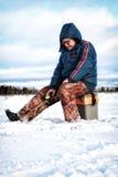 Winter-Fischer auf dem See Lizenzfreies Stockfoto