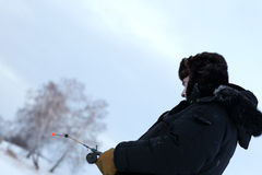 Winter fisherman Stock Images