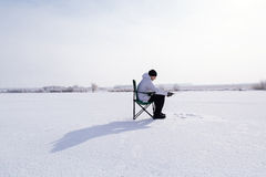 Winter fisherman on frozen lake Royalty Free Stock Photography