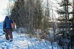 Winter fisherman walk fishing Royalty Free Stock Photo