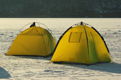 Winter fishermen's tents. Two bright yellow tents of winter fishermen Stock Images