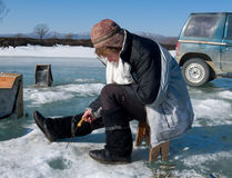 Winter Fishing. A winter fishing on river. People is fishing the smelt. Russian Far East, Primorye, Kievka river Royalty Free Stock Image