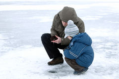 Winter fishing family leisure Royalty Free Stock Images