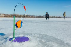 Winter fishing, fishing rod stands on the hole waiting for the fish. To bite Stock Photos