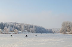 Winter fishing on frozen lake.  royalty free stock photo