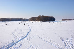 Winter fishing on frozen reservoir Royalty Free Stock Images