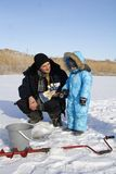 Winter fishing with grandpa Stock Images