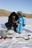 Winter fishing with grandpa Stock Image