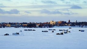 Winter Fishing Houses And Cars and Pickup Trucks On Frozen Lake Bemidji. Winter Fishing Houses on frozen Lake Bemidji in Minnesota on a late December afternoon stock footage