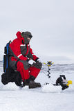Winter Fishing. Ice fishing in winter with all the tools to catch fish Stock Photo