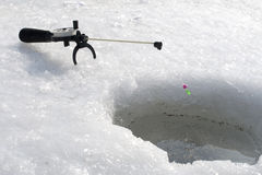 A winter fishing. On ice of river Stock Images