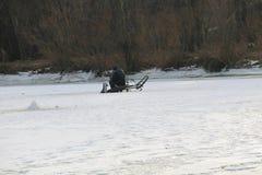 Winter fishing on a lake Stock Photography