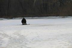 Winter fishing on a lake Royalty Free Stock Photo