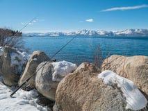 Winter fishing, Lake Tahoe, Nevada. Fishing from shore in Winter, Lake Tahoe, Nevada Royalty Free Stock Photography