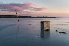 Winter fishing. The perfect end of the day Royalty Free Stock Image