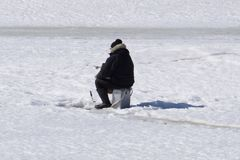 Winter fishing River, lake near forest in ice. Anglers, Fishermens during your favorite leisure time. With place for text, for squ stock photo