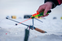 Winter fishing rod and knives Stock Images