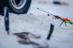Winter fishing rod and knives Royalty Free Stock Photo
