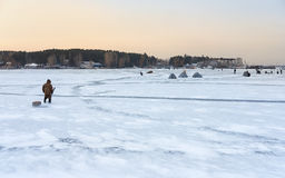 Winter fishing in Siberia - fisher`s tents on ice of Ob reservoi Royalty Free Stock Images
