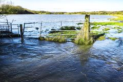 Winter flooding in Combe Valley near Bexhill, East Sussex, England. Heavy winter flooding in the valley of the Combe Haven river near Bexhill This view shows the royalty free stock photography