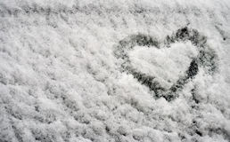 In winter, fluffy snow painted heart. Royalty Free Stock Photo