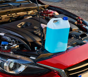 Winter fluid refilling in car. Winter service for safe driving. royalty free stock images